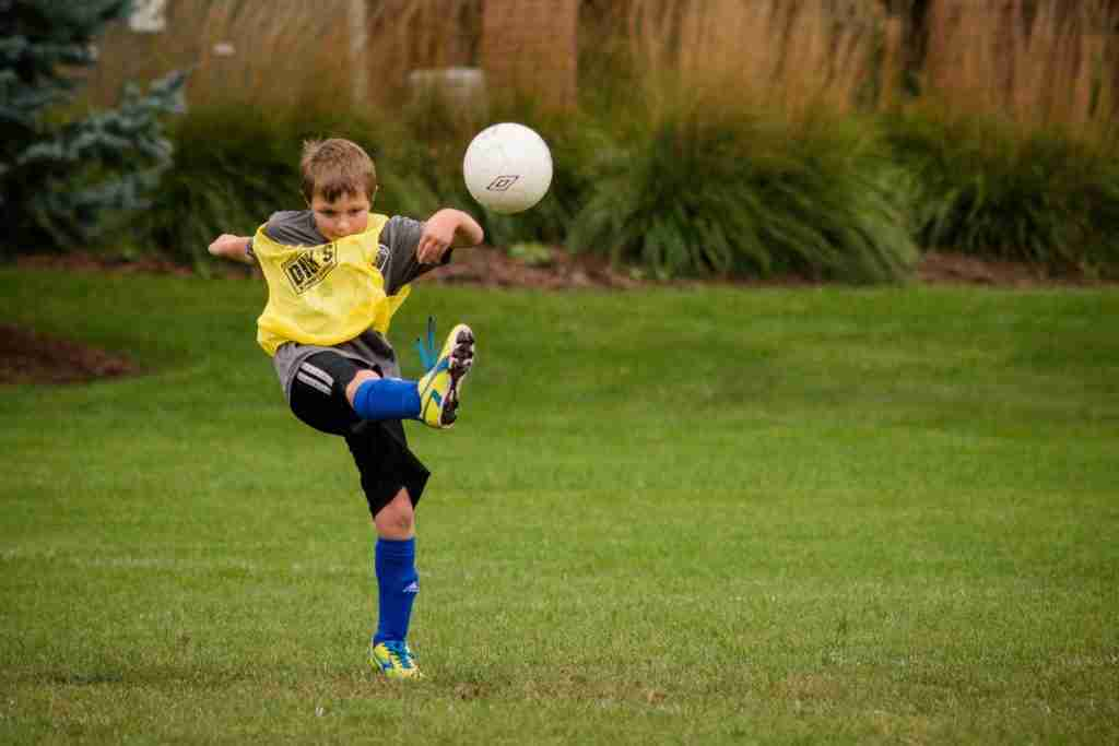 A boy plays soccer - photo of shutter speed used to freeze action