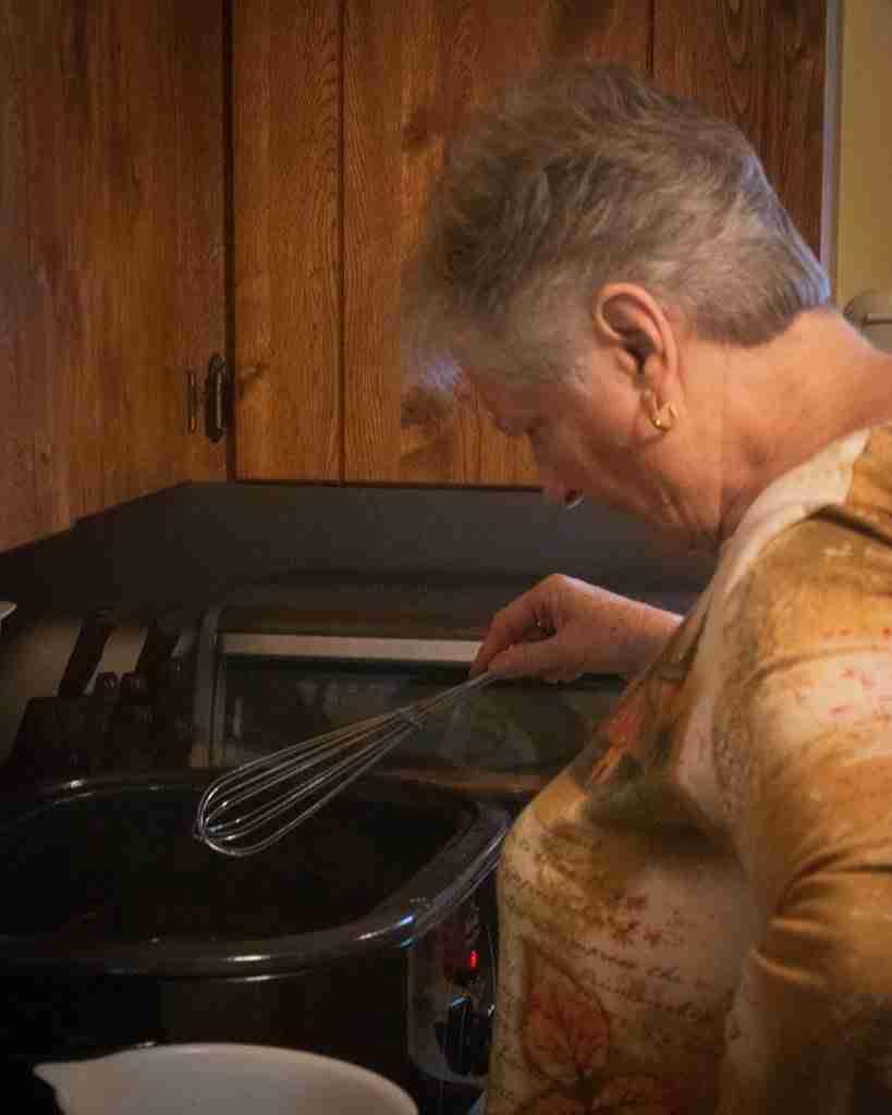 Mom making Thanksgiving gravy