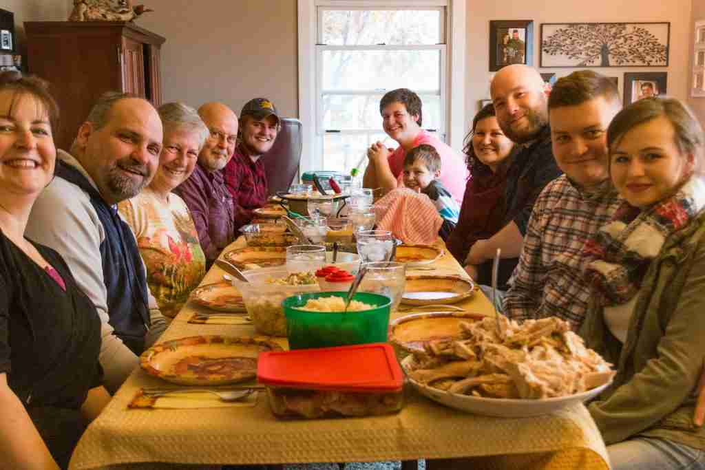 Family at Thanksgiving dinner table