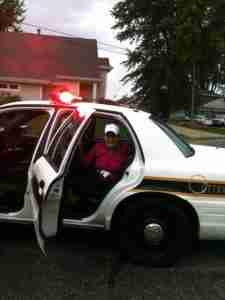 Author in Police Car