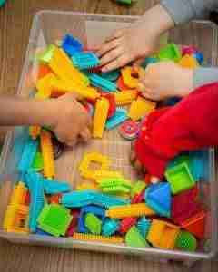 hands in bristle blocks