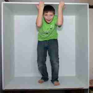 A boy in the box with his hands out