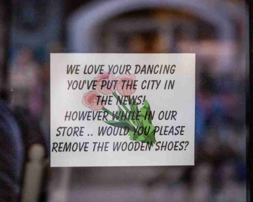 """sign in the door showing """"no wooden shoes"""" during holland michigan's tulip time"""