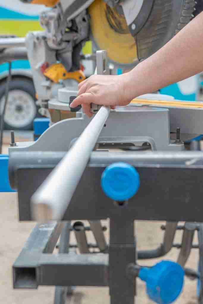Amazing and strong women uses the miter saw