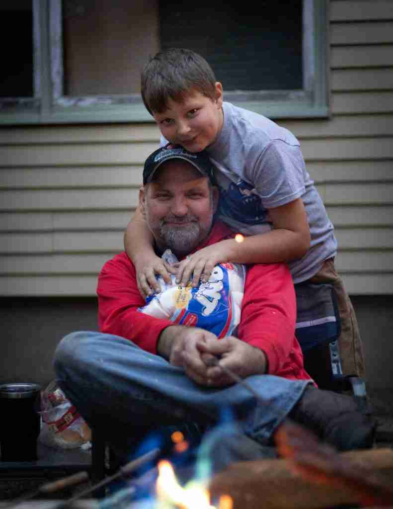 Dad and son by the firepit