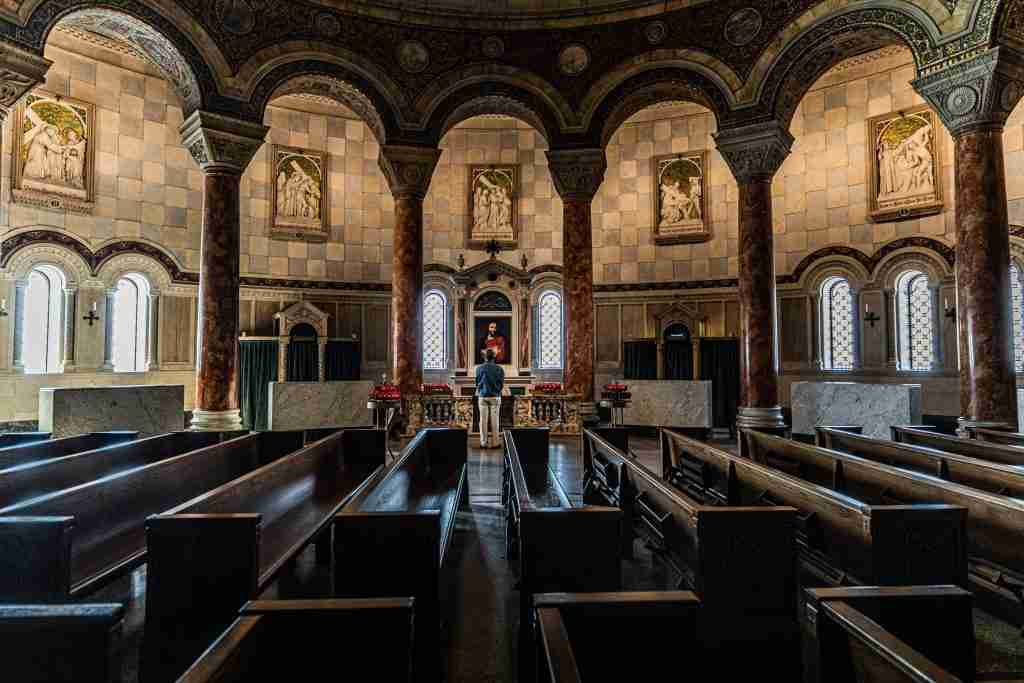 A man praying at an altar
