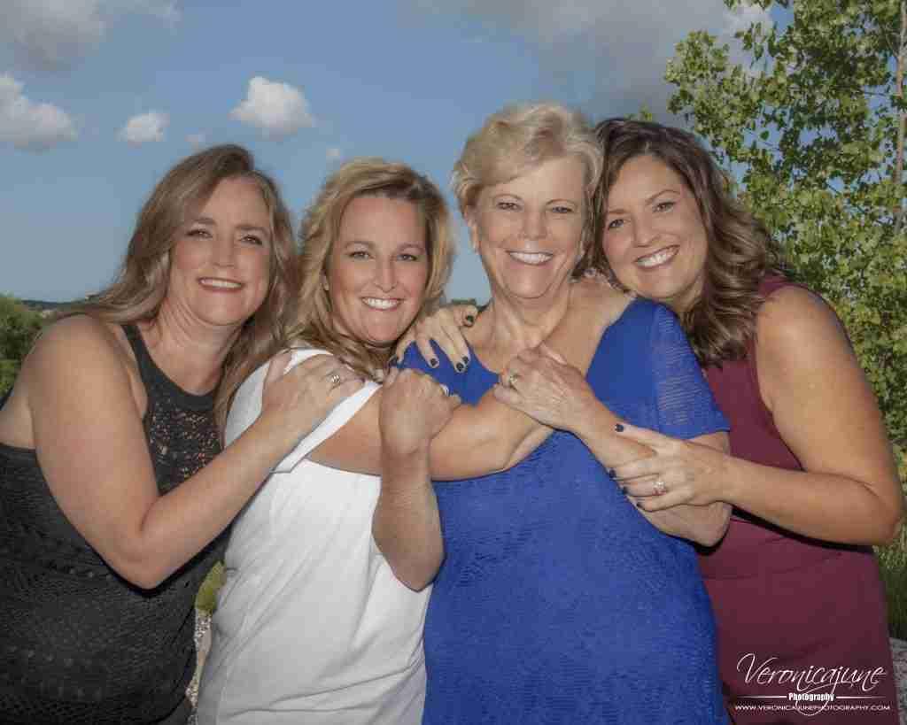 4 women, 3 hugging mom