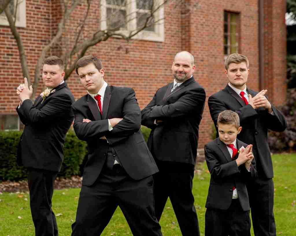 5 men posing like Charlie's Angels