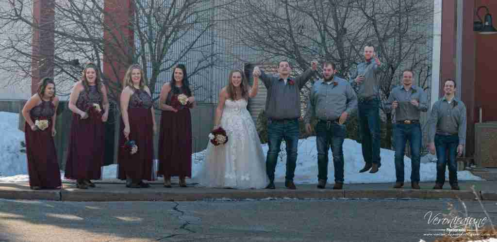 A wedding party jumping by prompt