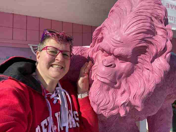 Author with a pink gorilla statue