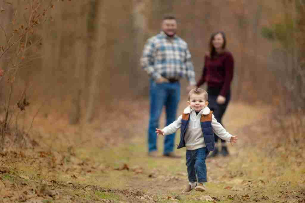 little boy running to camera using the run to photographer photography prompt for families