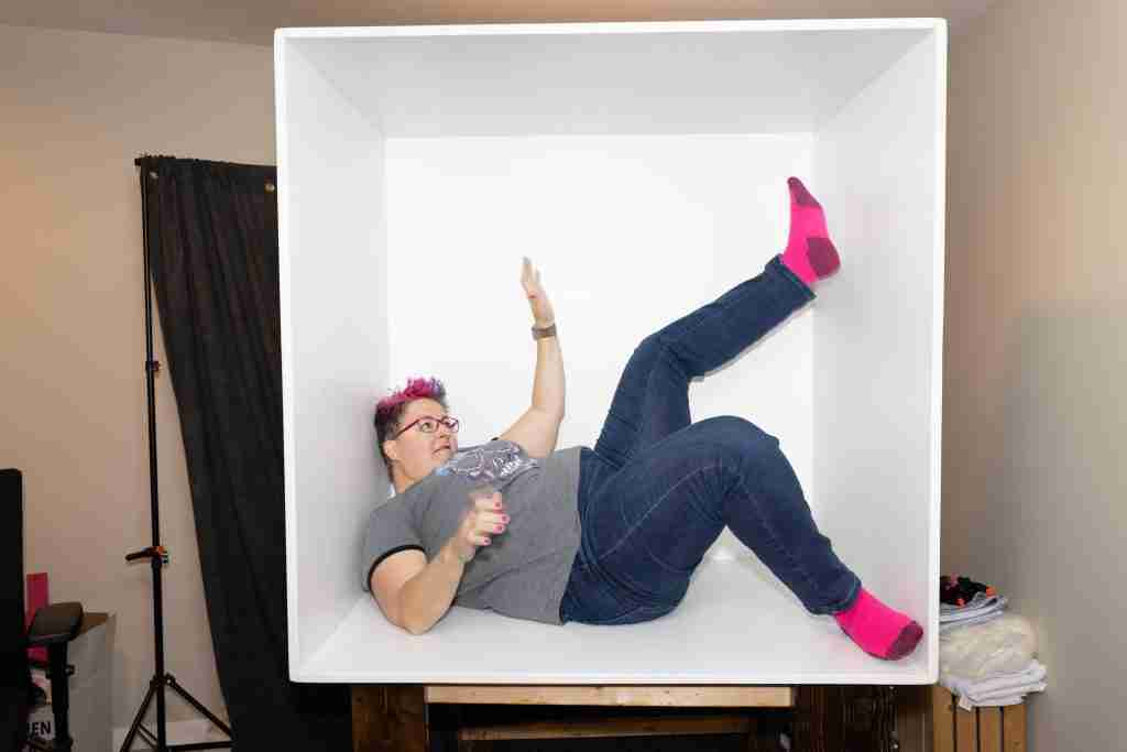 Woman twisting in box for box photo composite post