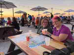 Two ladies toasting at Caddy's on the beach - one of the best places to eat in st pete fl