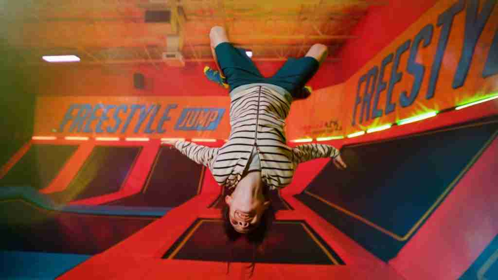 kid floating upside down at Urban Air - kid's party in Holland Michigan